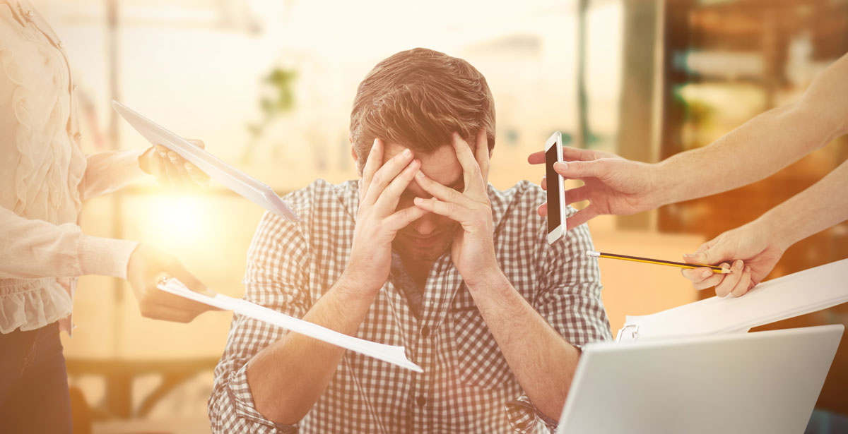 Businessman stressed out at company