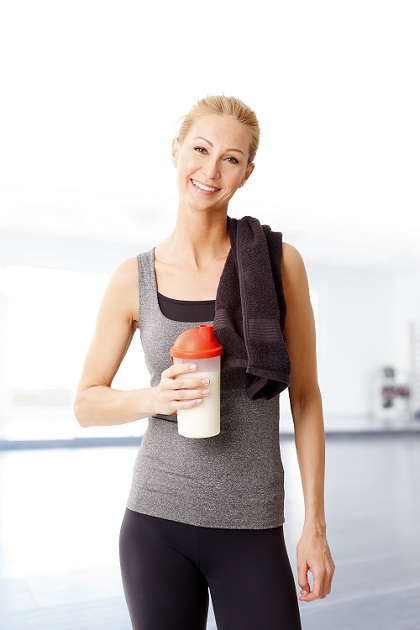 Woman drinking plant protein shake